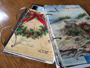 Christmas holiday cards organized into a book using binder rings